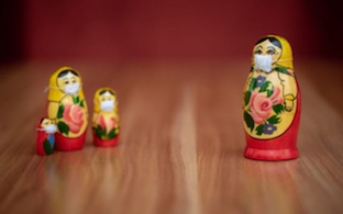 Russian dolls wearing masks social distancing for coronavirus